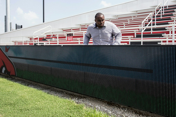 UofL Athletic Facilities crewmember Christian Graham inspects various aspects of the new soccer stadium before its official unveiling to the public on Wednesday afternoon.