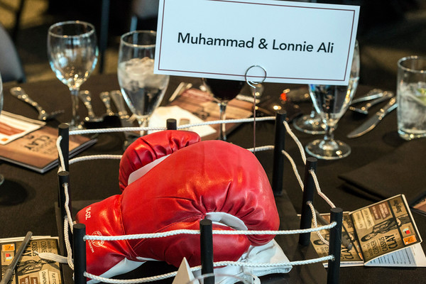 The centerpiece on each banquet table was a set of boxing gloves in a miniature boxing ring during Muhammad Ali's 73rd birthday party at The Ali Center on Saturday night. 1/17/15