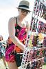 Kari Karich looks over the merchandise on sale at the Kentucky Reggae Festival on Saturday. 5/23/15