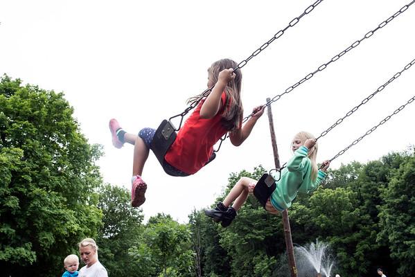 Jada Sturgill and Amelia Baker take flight on a swing set in Cherokee Park. 5/31/15