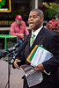 Jerald Muhammad reads from a NAACP report on the history of racial discrimination allegations against The Cordish Group, that includes examples of racism at Fourth Street Live, during a press conference on Wednesday morning. 7/22/15