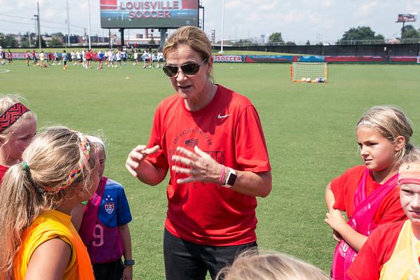 U.S. Women's National Soccer Team head coach Jill Ellis breaks down technique during a skills camp at Lynn Stadium on Sunday afternoon. 8/23/15