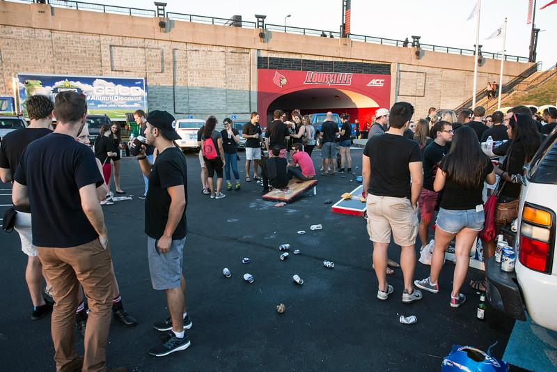 UofL dental students tailgate near the tunnel at Papa John's Stadium on Thursday night. 9/17/15