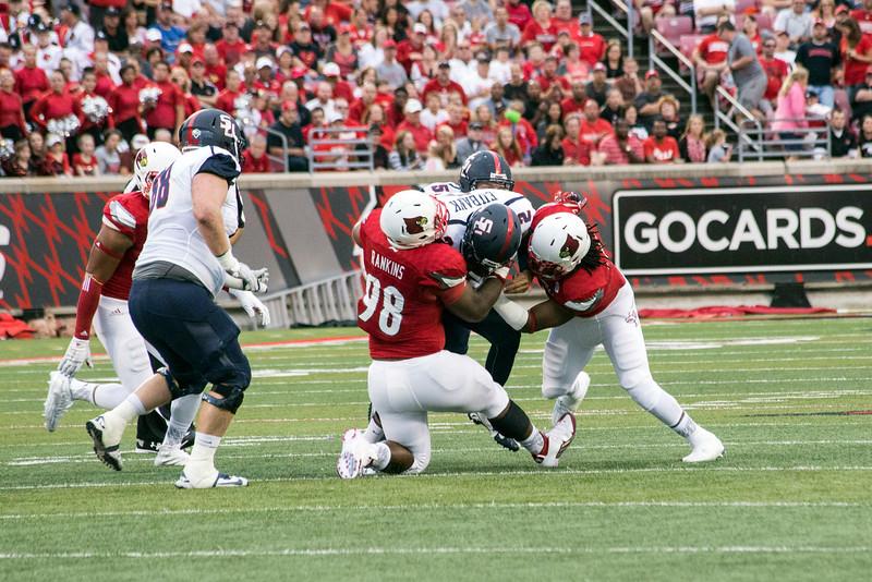 Samford quarterback Michael Eubank is sacked by UofL's Sheldon Rankins and Keith Brown. 9/26/15