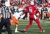 UofL quarterback Kyle Bolin evades pressure from Virginia defensive tackle David Dean. 11/14/15