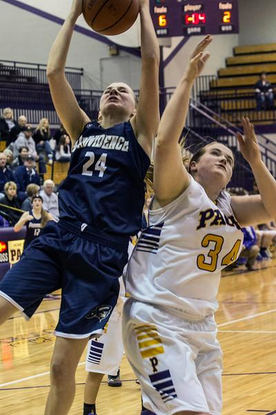 Providence High's Lexie Libs battles Paoli's Rachel Cadle for a rebound during the IHSAA Class 2A sectional on Friday night. 2/13/15