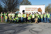 Thirty-eight Olmsted Parks volunteers line up for a group shot before spreading out in Seneca Park to remove invasive weeds on Thursday afternoon. 4/14/16