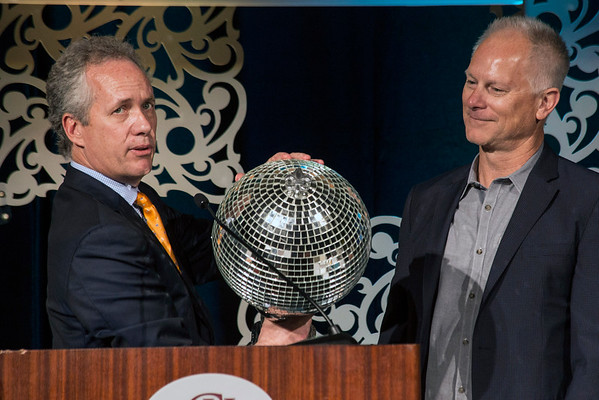 Louisville mayor Greg Fischer presents a locally-produced disco ball to ESPN personality Kenny Mayne during the 2016 KDF They're Off! Luncheon on Friday at The Galt House. 4/22/16