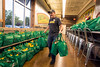 Kevin Dinson organizes the 250 bags of healthy groceries at Fresh Thyme on Wednesday morning. The newly opened St. Matthews location offered the bags for free to its first customers. 4/27/16