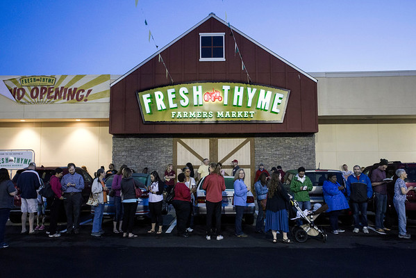 "Customers lined up before sunrise at the Fresh Thyme in St. Matthews on Wednesday morning. The newly opened store was offering a bag of ""healthy groceries"" to the first 250 people through the door. 4/27/16"