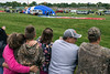 Spectators line the fence at the Kentucky Expo Center awaiting entry to the Great Balloon Glow as pilots begin inflating the massive attractions. 4/29/16