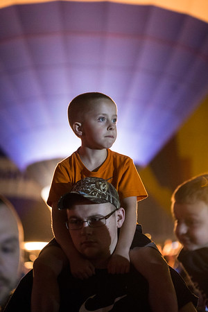 Jack Pope sits atop the shoulders of Austin McIntyre during the Great Balloon Glow at the Kentucky Exposition Center on Friday night. 4/29/16