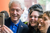 Several women gather around Bill Clinton for a selfie during a stop at the Heine Bros. Coffeeshop on Fourth Street Tuesday afternoon. 5/3/16