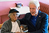 Roberta Wilson shares a few stories with former president Bill Clinton during a surprise stop at Franco's on Dixie Highway Tuesday afternoon. 5/3/16