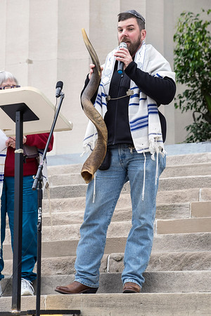 Rabbi Dusty Benham holds a shofar while speaking to those in attendance at the National Day of Prayer on Thursday. A shofar is a ram's horn used for Jewish religious purposes. 5/5/16
