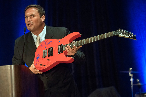 Evan Lamanna auctions off a Taylor Swift autographed guitar during the annual Ferdinand's Ball at the Marriott Downtown on Thursday night. 5/5/16