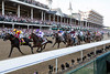 The field of horses rumble past on their way to the first turn during the 142nd running of the Kentucky Derby at Churchill Downs on Saturday afternoon. 5/7/16