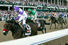 Jockey Mario Gutierrez raises a fist as he crosses the finish line atop winner Nyquist during the 142nd running of the Kentucky Derby on Saturday afternoon. 5/7/16 (Photo by Marty Pearl/Special to The Courier-Journal)
