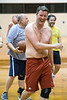 Matt Bergman laughs off being roughed up at the rim during a UofL staff and faculty basketball game in Crawford Gym on Friday afternoon. 5/13/15