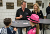 Ted Nugent and his wife Shemane Deziel greet a couple of young fans during a book signing session on Sunday at Freedom Hall. 5/22/16