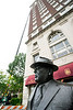 The statue of J. Graham Brown watches over renovations at the Brown Hotel as steel beams are lifted up 15 stories for a rooftop renovation project. 5/25/16