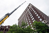 A crane with a 210-foot long boom spent Wednesday morning hoisting 50 tons of steel to the 15th floor of the Brown Hotel in preparation for a rooftop renovation. 5/25/16