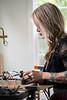 Gina Gentile-Moeller crafts jewelry in her St. Matthew's workshop. 5/25/16
