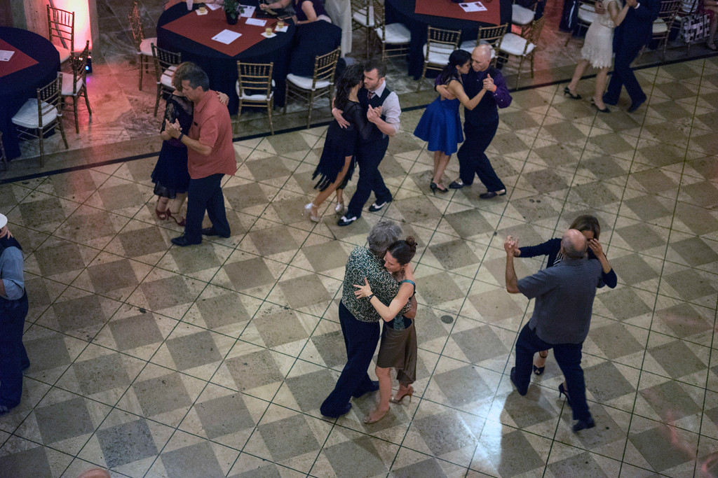Couples swirl about on the dance floor at The Gillespie during the Louisville Tango Festival on Friday night. 5/27/16