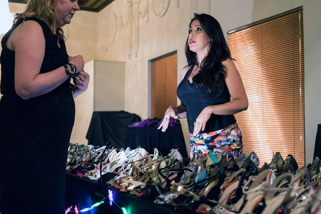 Designer Sandra Andel was set up at the Louisville Tango Festival to assist women with the proper dance shoes and attire. 5/27/16