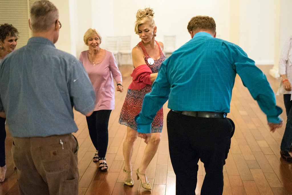Tango instructor Christy Byers leads a class of beginners during the Louisville Tango Festival at The Gillespie on Friday afternoon. 5/27/16