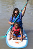 LaSonya Johnson and Sean Johnson try out a paddleboard together during the Hike, Bike, & Paddle on Monday at Waterfront Park. 5/30/16