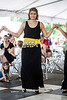 Athenian Dancer Elini Digenis Lentsch flashes a smile during a traditional dance performance at the Louisville Greek Festival on Saturday. 6/4/16