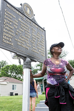Lynette Wilson of St. Louis, MO stops by the Ali childhood home on Grand Avenue to pay honor to the fallen champ on Saturday afternoon. 6/4/16