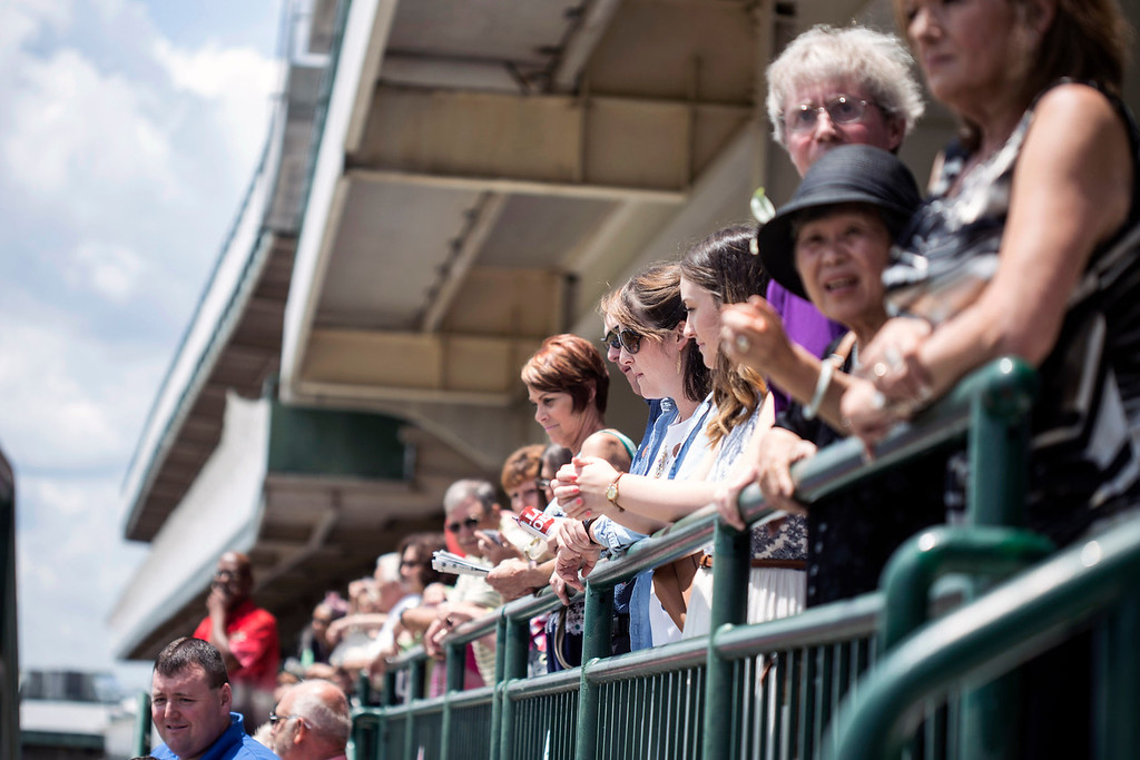 Fans line the rails on Millionaire's Row 4 at Churchill Downs during the Norton Cancer Institute's Survivor Celebration Day on Sunday. 6/5/16