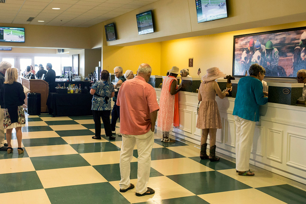 Betting windows were open in Millionaire's Row during the Norton Cancer Institute's Survivor Celebration Day at Churchill Downs. 6/5/16