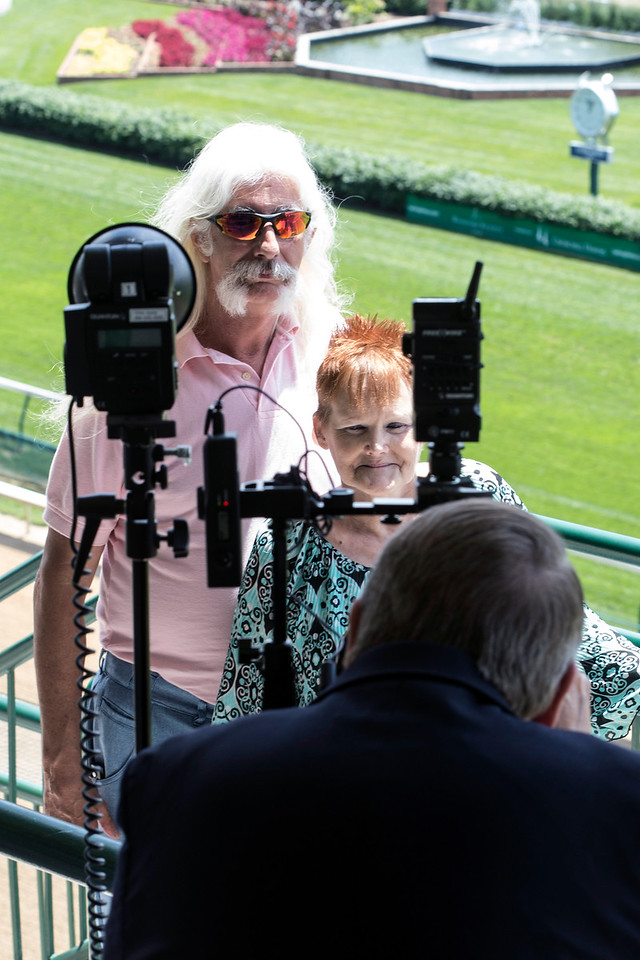 Donna DeArk and Paul Roth take advantage of the photo opp from Millionaire's Row during the Norton Cancer Institute's Survivor Celebration Day at Churchill Downs. 6/5/16