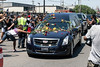 Fans toss roses onto the hood and roof of the hearse carrying Muhammad Ali as it makes its way east to Cave Hill Cemetery on Friday. 6/10/16