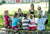 Erica Hinton reads to a group of children at King Solomon Apartments as they enjoy a free lunch and story from the Bridgepoint Read and Feed Bus. 6/29/16