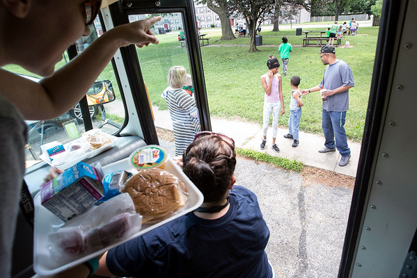 Lunches and books were delivered by the Read and Feed Bus to children at the King Solomon Apartments in Jeffersonville on Wednesday. 6/29/16
