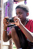Kyrel Grisby lines up his shot with the precision of a pro during Photo Love camp at the Southwick Community Center. 6/30/16