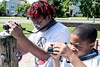 Niara Snowden and Damon Candler line up their cameras while working on a challenge at Photo Love camp at the Southwick Community Center. 6/30/16