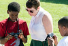 Sarah Davis of the Louisville Visual Arts Association takes a look at some of Kyrel Grisby's work during Photo Love summer camp at the Southwick Community Center. 6/30/16