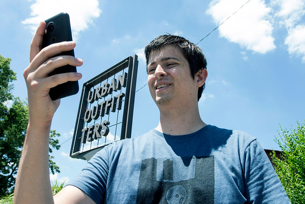 Will Rigby hunts down Pokemon along Bardstown Road in the Highlands using the Pokemon Go app on Monday afternoon. 7/11/16