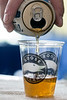 Beer is poured into sampling cups in a tent at the Blues, Brews & BBQ Festival. 7/22/16