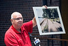 Mayor of Brandenburg Ronnie Joyner shows a photo of a proposed location in Meade County for the Confederate Statue during a public hearing on Monday. 7/25/16