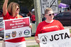 Teachers Trish LaPaille and Jodi Cox stand in support of the JCTA during a protest outside of a school board meeting on Tuesday. 7/26/16