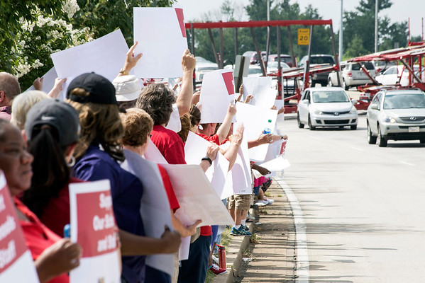 Members of the JCTA, and other support staff unions, gathered in front of the Van Hoose Center on Tuesday to stage a protest as the JCPS school board met to discuss labor issues. 7/26/16