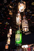 Whiskey bottles are repurposed as decorative lights in the colorful decor of HopCat. 7/27/16