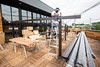 Rob Goff continues work on the upper level deck overlooking Baxter Avenue at the new HopCat as it nears opening weekend. 7/27/16