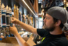 Adam Roberts installs customized craft beer taps as the HopCat staff prepares for opening weekend. 7/27/16